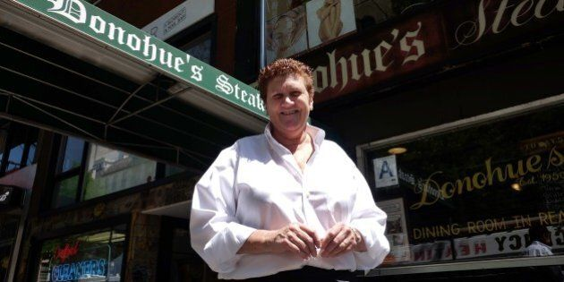 Maureen Donohue-Peters, a waitress at Donohue's Steak House, poses in front of the restaurant in New...