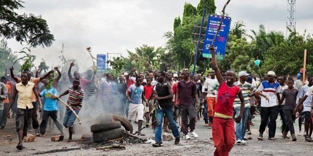 Demonstrators take part in a protest in Bujumbura on May 13, 2015. A top Burundian general announced...