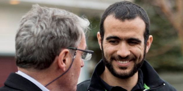 Omar Khadr, right, smiles at his lawyer Dennis Edney, left, as they speak to the media outside his new...
