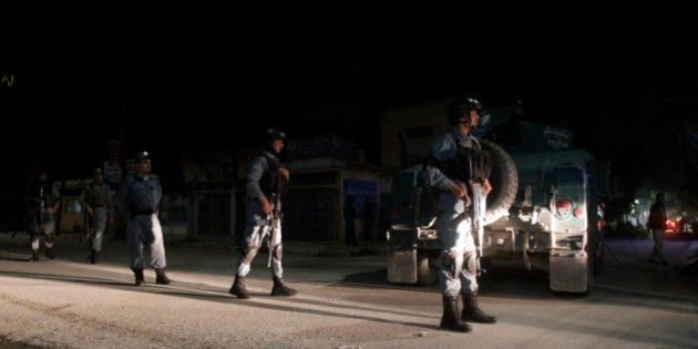 Afghan security forces inspect the site of a Park Palace Hotel attack by Taliban militants, in Kabul,...