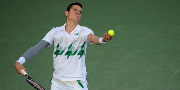 CINCINNATI, OH - AUGUST 13: Milos Raonic of Canada serves against Robby Ginepri during a match on day...