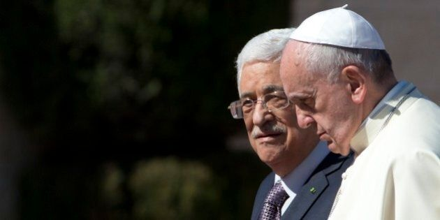 FILE - In this Sunday, May 25, 2014 file photo Pope Francis is welcomed by Palestinian President Mahmoud...