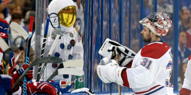 TAMPA, FL - MAY 12: A Tampa Bay Lightning fan dressed as an astronaut cheers in front of Carey Price...
