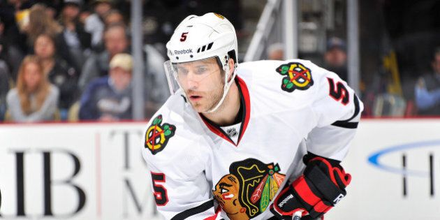 PITTSBURGH, PA - DECEMBER 20: Steve Montador #5 of the Chicago Blackhawks waits for a face off against...