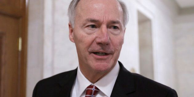 Arkansas Gov. Asa Hutchinson is interviewed in a hallway at the Arkansas state Capitol in Little Rock,...