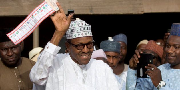 FILE - In this Saturday, March 28, 2015 file photo, opposition candidate Gen. Muhammadu Buhari holds...