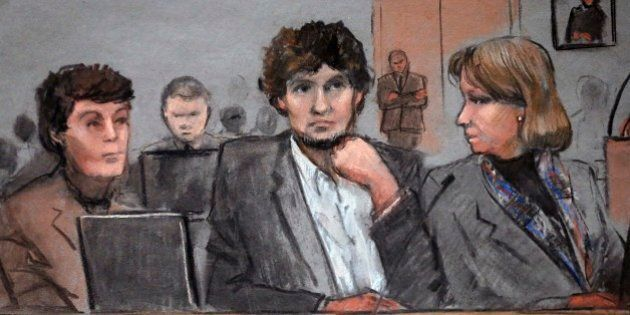 In this courtroom sketch, Dzhokhar Tsarnaev, center, is depicted between defense attorneys Miriam Conrad,...