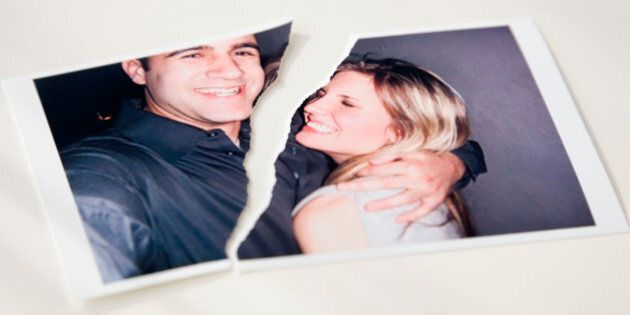 Photograph of couple ripped in
