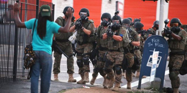 FERGUSON, MO - AUGUST 11: Police force protestors from the business district into nearby neighborhoods...