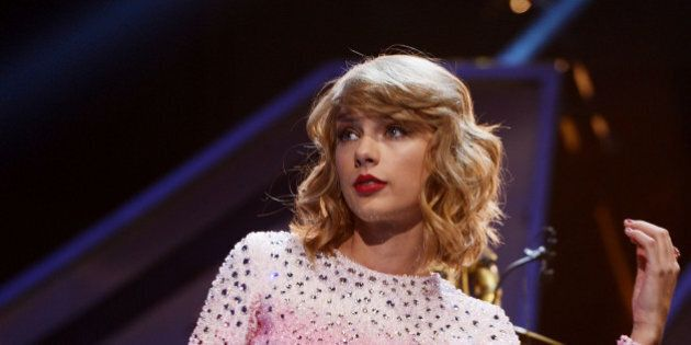 LAS VEGAS, NV - SEPTEMBER 19: Singer Taylor Swift performs onstage during the 2014 iHeartRadio Music...