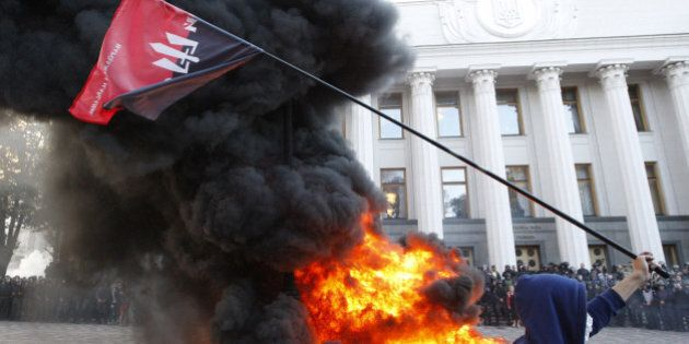 KIEV, UKRAINE - SEPTEMBER 16: Protesters burn tyres in front of the Ukrainian Parliament during a rally...