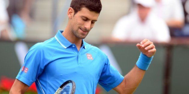 Novak Djokovic of Serbia reacts after winning a point against Roger Federer of Switzerland in the men's...