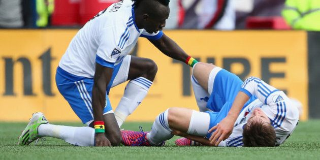 FOXBORO, MA - MARCH 21: Hassoun Camara #6 of Montreal Impact comforts Eric Alexander #29 after he was...