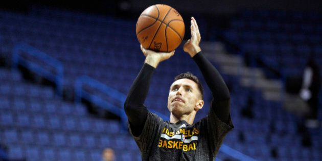 Los Angeles Lakers guard Steve Nash shoots during warmups for a preseason NBA basketball game against the Golden State Warriors, Sunday, Oct. 12, 2014, in Ontario, Calif. (AP Photo/Alex Gallardo)