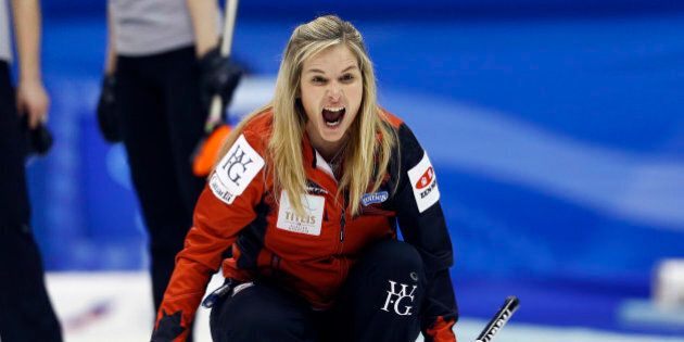 Canada's skip Jennifer Jones yells as the team plays Russia during the fourth end of their semifinal...