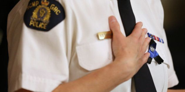 MONCTON, NB- JUNE 6 - Wearing a mourning ribbon Supt. Marlene Snowman, Officer in charge of the Codiac...
