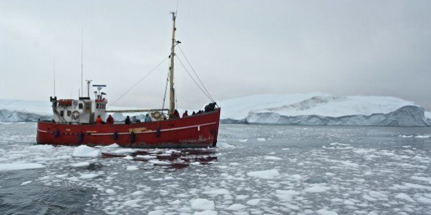GREENLAND - AUGUST 02: Ship among the icebergs that have broken off the Sermeq Kujalleq ice sheet, Ilulissat,...