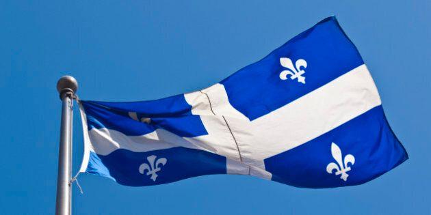 Large flag of Quebec fluttering in the