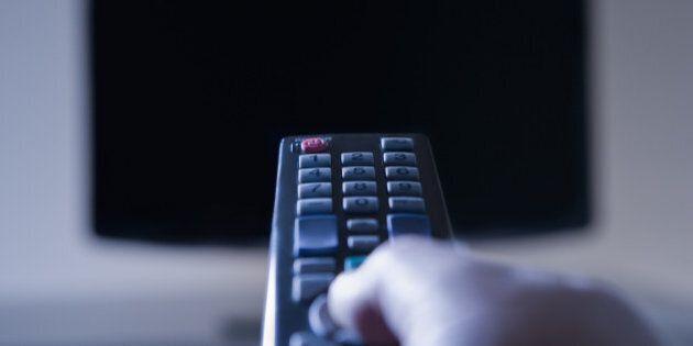 Hispanic man using remote
