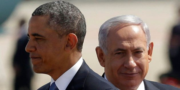 President Barack Obama, left, with Israeli Prime Minister Benjamin Netanyahu, right, during his arrival...