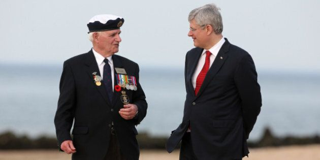 COURSEULLES SUR MER, FRANCE - JUNE 6: Canadian veteran William Gunter talks to Prime Minister of Canada...