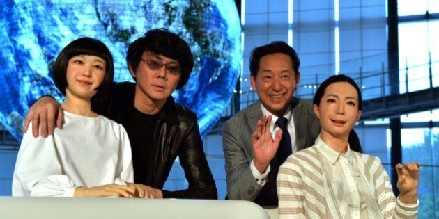 Former astronaut and the director of the museum, Mamoru Mori (2nd R), and Osaka University professor...
