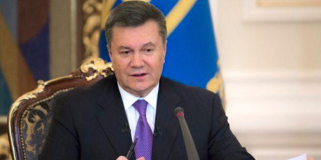 FILE - In this Thursday, Dec. 19, 2013 file photo Ukrainian President Viktor Yanukovych speaks during...