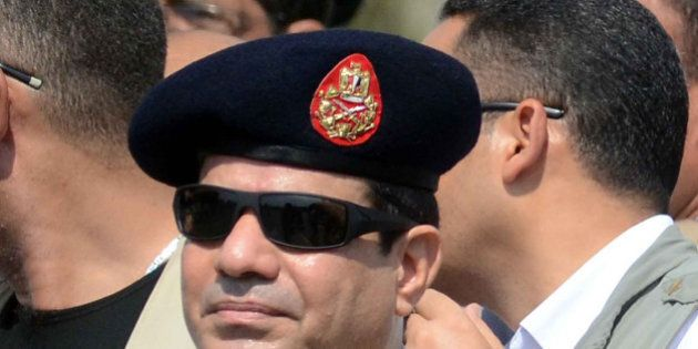 Egyptian Defense Minister and Military Chief General Abdel Fattah al-Sisi attends the funeral of Giza...