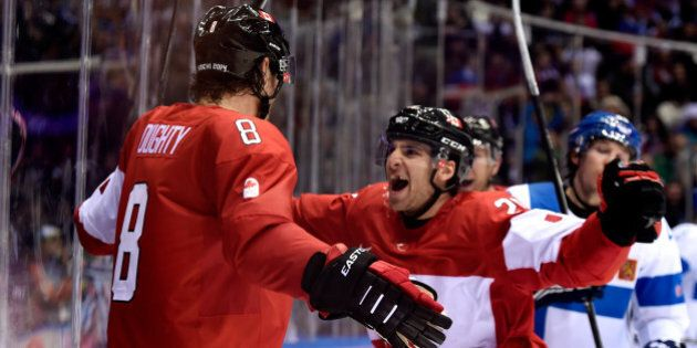 SOCHI, RUSSIA - FEBRUARY 16: Drew Doughty #8 of Canada celebrates with his teammate John Tavares #20...