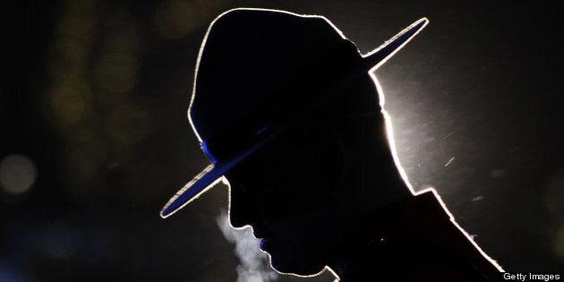 A Canadian mountie waits for the start of the medal ceremonies of the Vancouver Winter Olympics in Whistler...