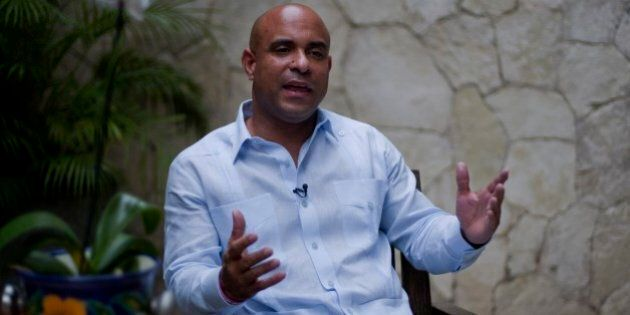 Former Haitian Prime Minister Laurent Lamothe speaks during an interview with Associated Press in Port-au-Prince,...