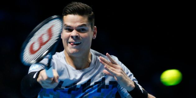 Canada's Milos Raonic plays a return to Switzerland's Roger Federer during their ATP World Tour Finals...