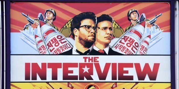 A poster for 'The Interview' is displayed on the marquee of the Los Feliz 3 cinema December 25, 2014...