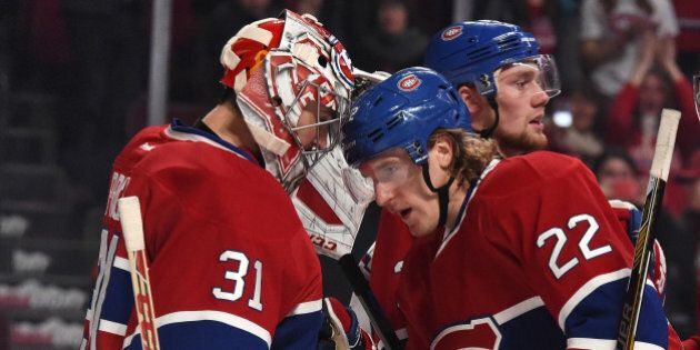 MONTREAL, QC - NOVEMBER 13: Dale Weise #22 of the Montreal Canadiens celebrates the victory with Carey...