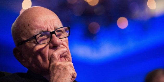 Rupert Murdoch, chairman of News Corp., listens as U.S. President Barack Obama, not pictured, speaks...