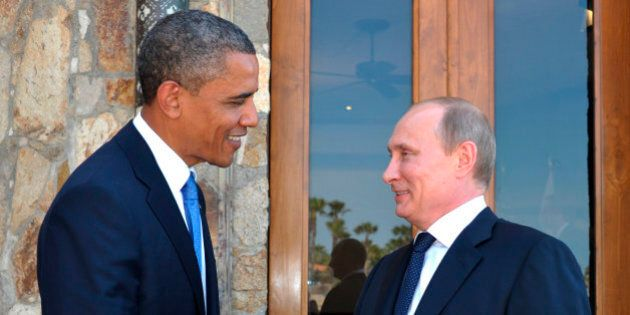 U.S. President Barack Obama, left, greets Russia's President Vladimir Putin at the G-20 Summit in Los...