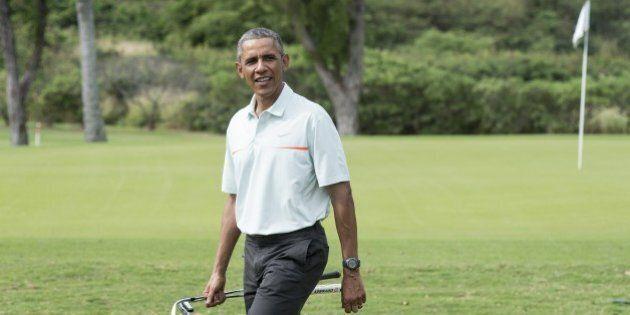 US President Barack Obama talks to reporters as he plays golf with Malaysian Prime Minister Najib Razzak...