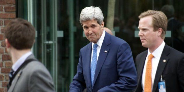 US Secretary of State John Kerry (C) is leaving Coburg Palais after his bilateral meeting with Iran's...