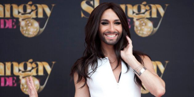 Austrian singer Conchita Wurst (Thomas Neuwirth) poses for photographers before receiving 'Madrid Orgullo'...