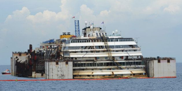 ISOLA DEL GIGLIO, ITALY - JULY 14: The wrecked ship Costa Concordia is seen having been raised by two...