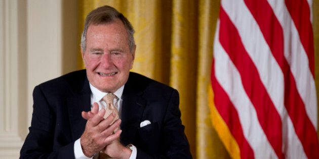 Former President George H. W. Bush applauds as he participated in a ceremony to present the 5,000th Daily...