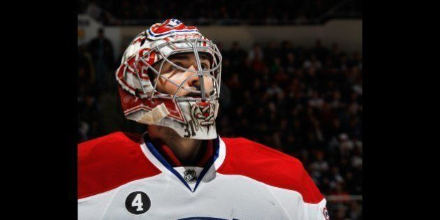 UNIONDALE, NY - DECEMBER 23: Carey Price #31 of the Montreal Canadiens tends net against the New York...