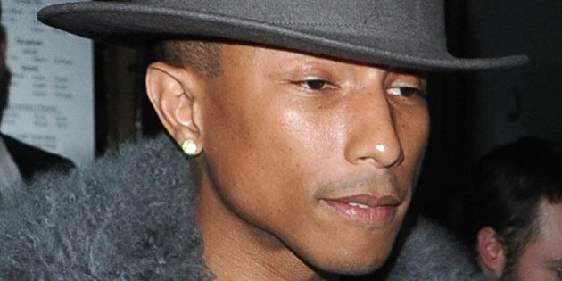LONDON, UNITED KINGDOM - FEBRUARY 05: Pharell Williams leaving Nobu Restaurant on February 5, 2014 in...