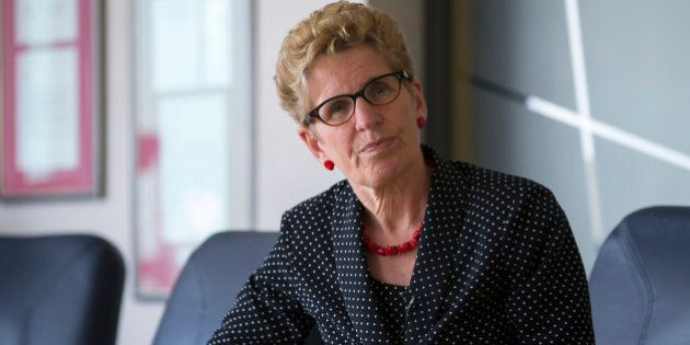 TORONTO - MAY 22: Ontario Premier Kathleen Wynne listens to questions from members of the Toronto Star...