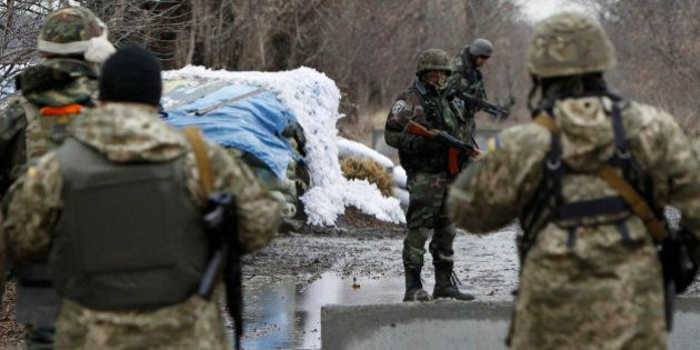 Ukrainian government army soldiers at a check-point near the village of Debaltseve, Donetsk region, eastern...
