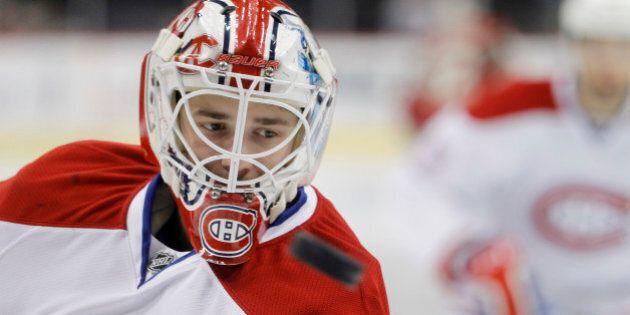Montreal Canadiens goalie Dustin Tokarski skates during warmups before an NHL hockey game against the...