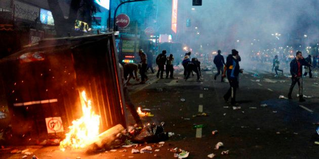 BUENOS AIRES, ARGENTINA - JULY 13: Fans of Argentina clash with riot police after FIFA World Cup final match between Germany and Argentina, at 9 de Julio Avenue on July 13, 2014 in Buenos Aires, Argentina. (Photo by Segundo Saavedra/LatinContent/Getty Images)