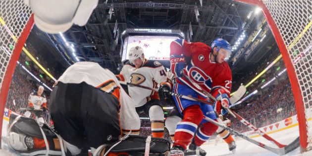MONTREAL, QC - DECEMBER 18: Frederik Andersen #31 of the Anaheim Ducks makes a save against the Montreal...
