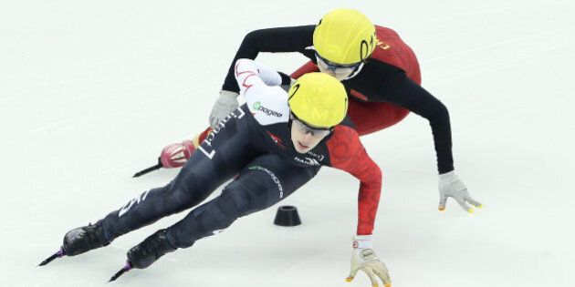 SHANGHAI, CHINA - DECEMBER 13: Marianna St-Gelais of Canada and Liu Yang of China compete in the Ladies...