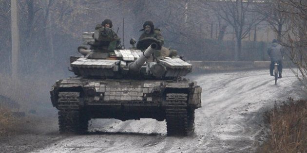 DONETSK, UKRAINE - DECEMBER 11: Ukrainian army forces patrol in the Tonenkoe town near Donetsk International...